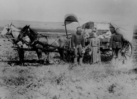 The Covered Wagon of the Great Western Migration. 1886 in Lo