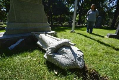 20130812_CEMETERY_VANDALS_045.jpg A damaged statue from the Civil War veterans monument is seen without a head, Monday, Aug. 12, 2013, at Mountain View Cemetery in Longmont. 106 headstones were knocked damaged by vandals over the weekend. (Matthew Jonas/Times-Call)